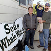 Adam Rosell and his son Aidan, 4, of Gloucester, stand with co-owner and Captain of the 7 Seas Whale Watch, Paul Frontiero, left, after an exciting trip where they witnessed two fin whales feeding near the boat. 7 Seas Whale Watch will make their last trip of the season on Sunday. David Le/Gloucester Daily Times