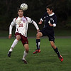 Rockport senior Andrew Burnham flicks the ball over the head of Hamilton-Wenham defender Tyler Bussone on Wednesday evening David Le/Gloucester Daily Times