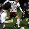 Rockport senior Andrew Burnham (28) brings the ball upfield against Hamilton-Wenham on Wednesday evening. David Le/Gloucester Daily Times