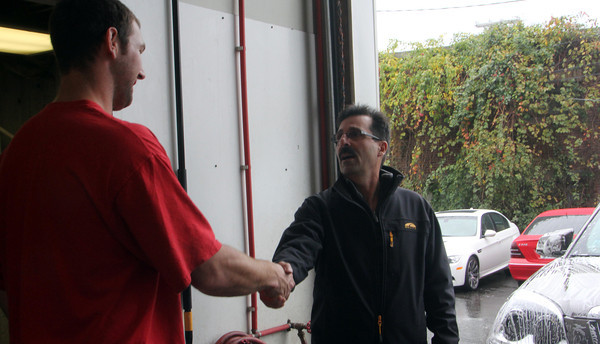 Steve Curcuru, right, incumbent Ward 3 councilor, shakes the hand of Steven Monteiro of SRM Deatailing, a business at the end of Whittemore Street in Ward 3 on Wednesday afternoon. Jesse Poole/Gloucester Daily Times Oct. 26, 2011