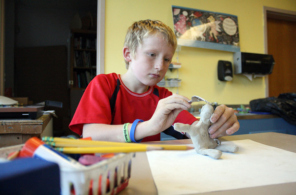 Rockport Elementary School 4th Grader, Sean Kern, works on a clay figure in sculpting class on Friday afternoon. Jesse Poole/Gloucester Daily Times