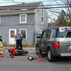 A motorcycle ran into a car at the corner of Goodwin Court and Eastern Ave in Essex Tuesday afternoon. The operator of the motorcycle was taken by ambulance.  Photo by Amy Sweeney.