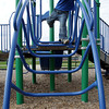Avery Traver, 3, of Gloucester, climbs along the bars at the Fort Playground on Tuesday afternoon. David Le/Gloucester Daily Times