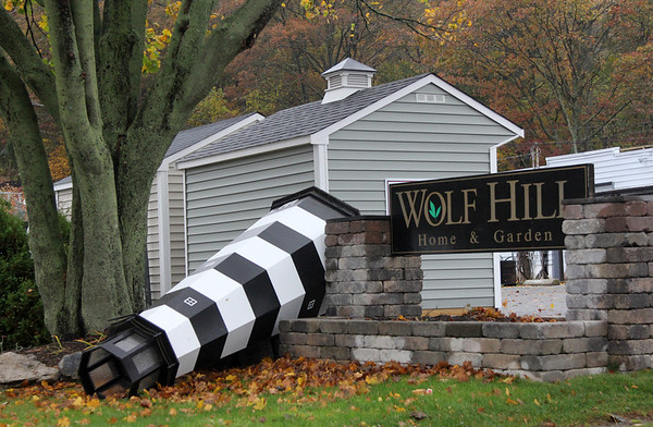 Allegra Boverman/Gloucester Daily Times. A lighthouse display overturned at Wolf Hill Home & Garden on Eastern Avenue in Gloucester during the hurricane on Monday.