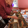 Allegra Boverman/Gloucester Daily Times. Ruth Brown of Rockport talks about the works of art she has been collecting over the years including three works she is examining by Theresa Bernstein.