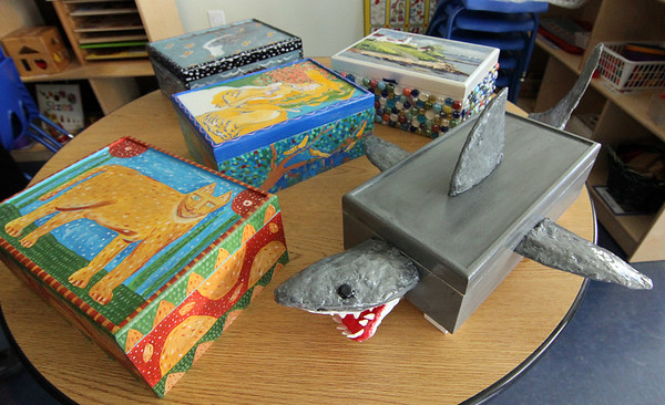 """Allegra Boverman/Gloucester Daily Times. These decorated boxes will be part of the silent auction during the upcoming Pathways For Children Gala, """"A Place at the Table,"""" set for November 9."""