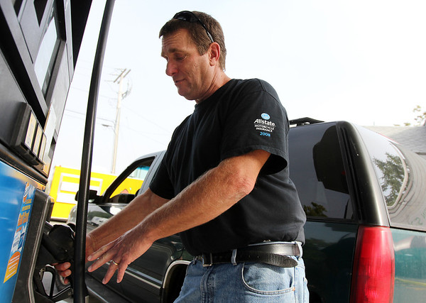 Allegra Boverman/Gloucester Daily Times. jon Chandler of Lanesville gives his opinion about the current prices of gasoline at the Twin Stop Gulf gas station on Eastern Avenue in Gloucester on Friday.