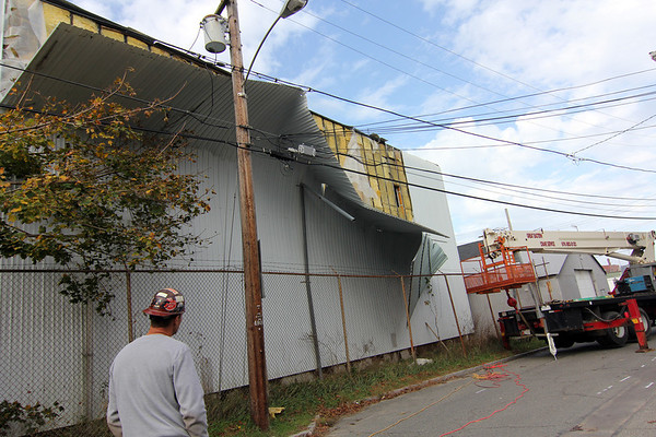 Allegra Boverman/Gloucester Daily Times. Parts of the Birdseye Building were damaged on Monday evening by Hurricane Sandy. Workers were on the scene in the Fort neighborhood to repair it but the utility company had not yet come by to turn off power so they could do the repairs.
