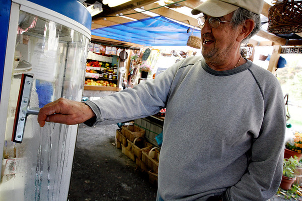 Allegra Boverman/Gloucester Daily Times. Jack Kusulas of Jack's Farm Stand in Essex clears condensation from the refrigerator case holding his very popular pies that come in 10 flavors on Monday. He is taking orders for Thanksgiving. Stop in to his farm daily from 10-7, at 105 Southern Avenue, Essex to order and chat with him. He also still has lots of fresh fruits and vegetables, several kinds of apples, heirloom tomatoes, gourds, pumpkins and mums.