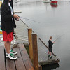 Allegra Boverman/Gloucester Daily Times. Tyler Malik, top, and Jack Colpoys, both 13 and eighth graders at Manchester-Essex Middle School, <br /> were fishing for bait at the town docks on Friday afternoon. They plan to fish later on in the same area for stripers and bluefish with the bait they were catching.