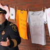 Allegra Boverman/Gloucester Daily Times. During the outdoor domestic violence awareness and recommitment ceremony held at the Gloucester Police Station on Tuesday to commemorate October as Domestic Violence Awareness Month and The Clothesline Project. New Gloucester Police Chief Leonard Campanello was welcomed to the city and spoke.
