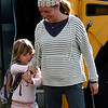 Allegra Boverman/Gloucester Daily Times. Heather Mosher, right, of Rockport, picks up her daughter Cosima Mosher-Owens, 5, from the bus stop along Mount Pleasant Street in Rockport on Tuesday afternoon.