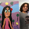 "Allegra Boverman/Gloucester Daily Times. Ilyana Lorenzana, 8, shows off her finished painting that she created as part of the Pathways for Children Art Club. Her painting and that of other kids will be auctioned at the upcoming Pathways ""A Place at the Table"" gala on Nov. 9."
