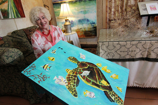 "ALLEGRA BOVERMAN/Gloucester Daily Times. Rose-Marie Glen of Annisquam with her Parsons Table titled ""Under the Deep Blue Sea - Hawaii."""