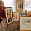 Allegra Boverman/Gloucester Daily Times. Ruth Brown of Rockport talks about the works of art she has been collecting over the years including the works near her. From left are a work by Tom Sutherland, Ron Straka and Fred Macneil. Above, a work by Florence Bradenberg.