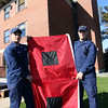 ALLEGRA BOVERMAN/Gloucester Daily Times These are the hurricane warning flags that the U.S. Coast Guard puts up on their rooftop flagpole to alert mariners that winds are 74 miles per hour or higher. From left, holding the flags, are Sean Gross of Seattle and Petty Officer Tom Moen of Foxborough.