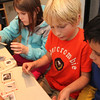 Allegra Boverman/Gloucester Daily Times. Veterans' Memorial Elementary School fourth graders Kaitlyn Chinault, Seth Balestraci and Jholly DeFreitas work together to figure out what kinds of plankton they are looking at during a visit to Maritime Gloucester on Wednesday afternoon.