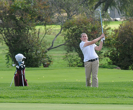 Jim Vaiknoras/Gloucester Daily Times: Rockport's Abby Hood chips on the green at the first hole during the teams match against Newburyport at Rockport Country Club Monday.