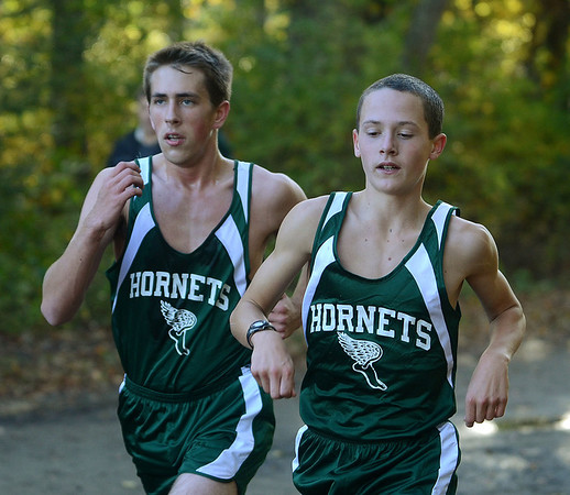 MIKE SPRINGER/Gloucester Daily Times<br /> Eighth grader Spencer Feuerbach, right, and junior Erik Rajunas compete in a cross country match against Masconomet and Pentucket Friday at Gordon College in Wenham.