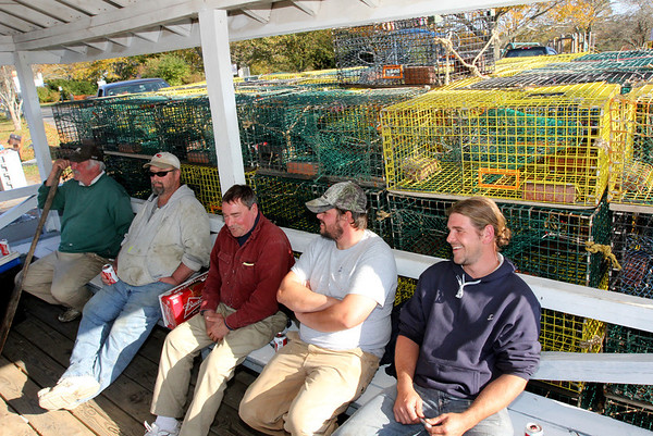 ALLEGRA BOVERMAN/Gloucester Daily Times. Lobstermen in Manchester talk about the impending storm on Friday afternoon. From left are: Stan Koch of Manchester, John Herrick of Gloucester, Mark Chafey of Manchester, Charlie Herrick of Gloucester and Eric Doucette of Manchester.