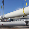 Allegra Boverman/Gloucester Daily Times. Pieces of one wind turbine destined for Gloucester Engineering in the Blackburn Industrial Park arrived by barge on Tuesday to Cruiseport. Three large pieces were unloaded and will be moved, base first, on Wednesday, Thursday and Friday. The blades will arrive later on by truck from Pennsylvania.