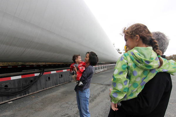 Allegra Boverman/Gloucester Daily Times. The Bolognese family of Winchester was checking out the wind turbine blades at Varian division of Applied Materials in Blackburn Industrial Park on Friday. Ralph Bolognese works at the company in finance and his family met him for lunch there. From left are: Andrew and his mom, Karen, Anne, 6, her dad Ralph and (hidden behind them) Will, 3.