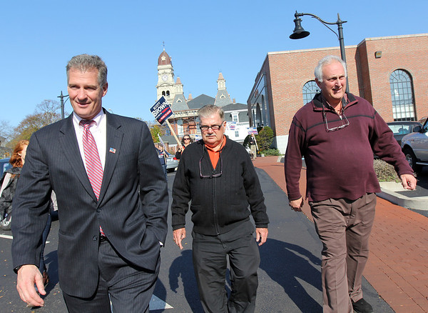 ALLEGRA BOVERMAN/Gloucester Daily Times. Republican U.S. Sen. Scott Brown, left, visited Gloucester on Friday morning and stopped  to City Hall to greet the mayor and city council members. He then walked downtown and visited with voters and businesses with some of them, including Bob Whynott, center, and Joe Ciolino,right and (not shown) Sen. Bruce Tarr.