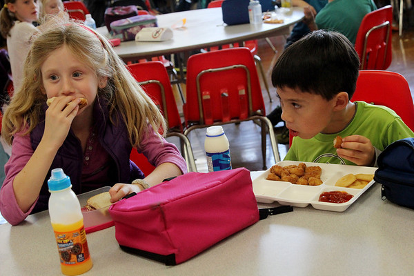 Allegra Boverman/Gloucester Daily Times. Riley Huber, left and Zachary Lee, both second graders who don't know each other, were seated at lunch together and with other kids from their grades and third graders, too while <br /> they were participating in the annual Mix-It-Up lunch held at the school<br /> during which pupils were seated at tables with children they don't normally sit with and some special guests visited to sit with them, too.