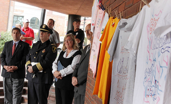 Allegra Boverman/Gloucester Daily Times. During the outdoor domestic violence awareness and recommitment ceremony held at the Gloucester Police Station on Tuesday to commemorate October as Domestic Violence Awareness Month and The Clothesline Project. From left during the ceremony are Sen. Bruce Tarr, new Gloucester Police Chief Leonard Campanello, Gloucester Mayor Carolyn Kirk and Gloucester Schools Superintendent Dr. Richard Safier.