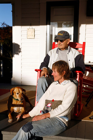 Allegra Boverman/Gloucester Daily Times. Betsy Eck and Frank Faralora, along with their dog Taz, enjoy the late afternoon sun at their Inn on Cove Hill in Rockport on Thursday afternoon. They had been doing some yard work.