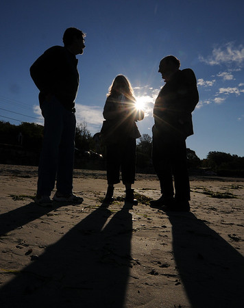 JIm Vaiknoras/Gloucester Times: Elizabeth McKim, Carl Carlsen, and Walter Skold read poems from local poet Vincent Ferrini on Niles Beach in Gloucester early Monday morning as part of Dead Poets Remembrance Day.