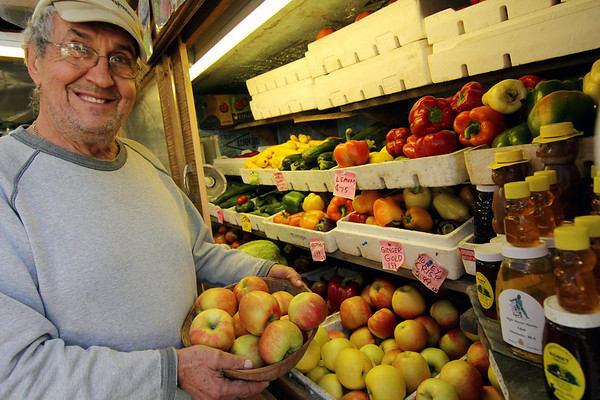 Allegra Boverman/Gloucester Daily Times. Jack Kusulas of Jack's Farm Stand in Essex with some of his various kinds of apples available at the stand. He is taking orders for his very popular pies for Thanksgiving. Stop in to his farm daily from 10-7, at 105 Southern Avenue, Essex to order from the 10 varieties he carries and chat with him. He also still has lots of fresh fruits and vegetables, several kinds of apples, heirloom tomatoes, gourds, pumpkins and mums.