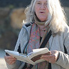 JIm Vaiknoras/Gloucester Times: Elizabeth McKim reads from a book of poems by local poet Vincent Ferrini on Niles Beach in Gloucester early Monday morning as part of Dead Poets Remembrance Day.