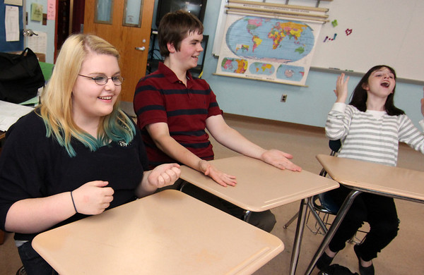 Allegra Boverman/Gloucester Daily Times. From left are Alexandra Legendre, Nelson Pike and Kelly Biondo stumped over a quiz question's answer on Tuesday afternoon at Rockport High School.