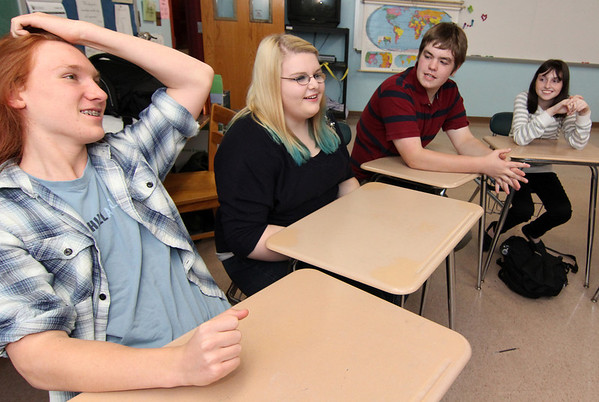 Allegra Boverman/Gloucester Daily Times. From left are  Sayles Kasten, Alexandra Legendre, Nelson Pike and Kelly Biondo stumped over a quiz question's answer on Tuesday afternoon at Rockport High School.