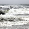 Allegra Boverman/Gloucester Daily Times. Layers of high surf and blowing foam along Cape Hedge Beach in Rockport on Monday during the hurricane on Monday.