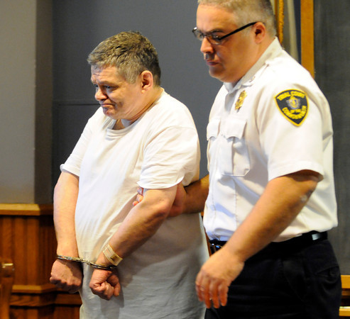 PAUL BILODEAU/Staff photo<br /> <br /> Norman Pike sits is brought into Lawrence Superior Court after pleading guilty to manslaughter in a 1976 killing in Gloucester.