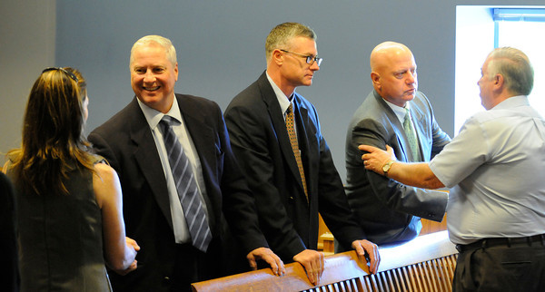 PAUL BILODEAU/Staff photo<br /> <br /> The detectives who helped solve the decades old murder in Gloucester is thanked by members of the victims family after the sentencing in Lawrence Superior Court.  They are, from left, Steven Mizzoni of the Gloucester Police. State Police detective Josh Ulrich and former Gloucester Poilce Det. Michael Lane.