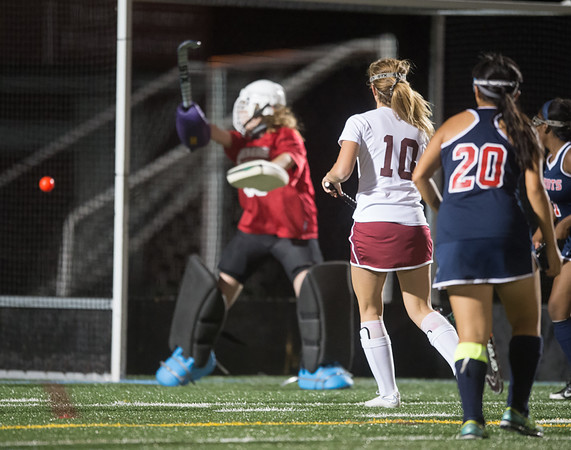 Desi Smith Photo.  Gloucester's Gabby Machado (10) scores on Revere's goalkeep Samantha Karl (60) during their match up at Newell Stadium Wednesday night. October 19,2016