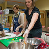 Desi Smith Photo.   Elise Koob of Rockport (right) works with volunteer Suzanne Gosselen of Backyard Growers making a vegetable stuffing,Tuesday night at the Open Door on Emerson Ave, were she and others learn to cook using local harvest.   October 18,2016