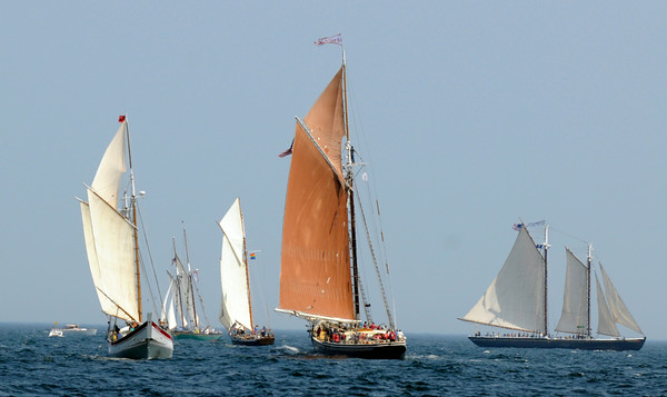 PAUL BILODEAU/Staff photo. Schooners head for the first mark during Mayors Race during the 30th annual Gloucester Schooner Festival.
