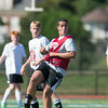 DESI SMITH/Staff photo.   Gloucesters Thiago DaSilva passes the ball against Manchester in a Soccer Jamboree held saturday morning at New Balance Track and Field at Newell Stadium.   August 30,2014