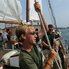 PAUL BILODEAU/Staff photo.Crew member Alex Snider on the Liberty Clipper, which is based out of Boston, helps pull up the mainsail during the 30th annual Gloucester Schooner Festival.