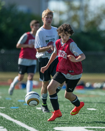 DESI SMITH/Staff photo.   Gloucesters Gianluca Locontro moves the ball against Manchester in a Soccer Jamboree held saturday morning at New Balance Track and Field at Newell Stadium.   August 30,2014