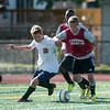 DESI SMITH/Staff photo.  Manchesters Henry Rohner, and Gloucesters Chris MacDonald, look to control the ball in a Soccer Jamboree held saturday morning at New Balance Track and Field at Newell Stadium.   August 30,2014