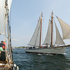 PAUL BILODEAU/Staff photo. The schooner the American Eagle passes by the Liberty Clipper, which is based out of Boston, during the 30th annual Gloucester Schooner Festival.