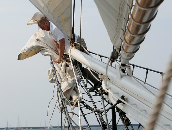 PAUL BILODEAU/Staff photo. Crew members on the Liberty Clipper, which is based out of Boston, pull out the job during the 30th annual Gloucester Schooner Festival.