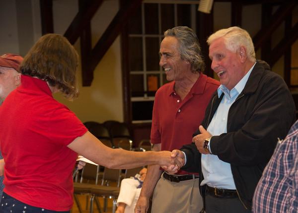 Desi Smith/Staff Photo.        Rebecca B Borden congratulates Everett W Brown