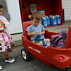 Manchester: Lola Fortunato-McElwain, 3, and her brother, Luca, 1, stop at Richdale's for orange juice while out with their grandmother yesterday afternoon. Photo by Kate Glass/Gloucester Daily Times Tuesday, September 22, 2009