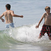 Rockport: Liam Korona, 12, right, waits for the cold wave to hit him while swiming with his brother Edward at Cape Hedge Beach Saturday morning. Mary Muckenhoupt/Gloucester Daily Times
